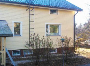 Rapattu talo sai remontissa puuverhouksen